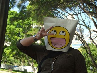 Paper_bag_mask_with_4chan_smiley_at_Anon_raid